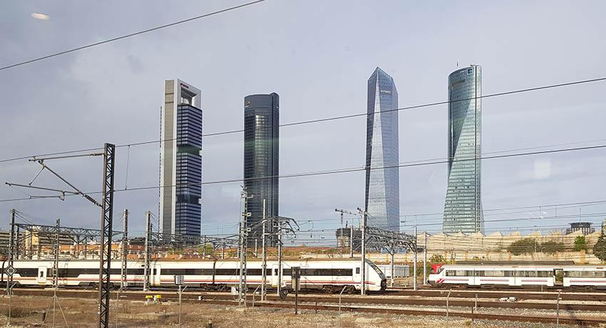 madrid train station backdrop with skyscrapers