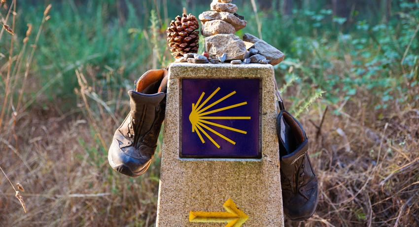 Mile marker with hiking boots