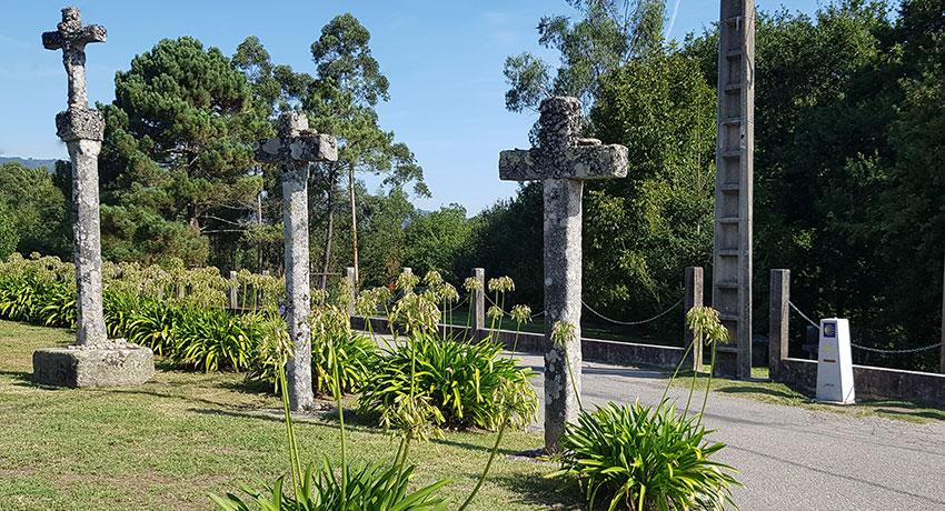 three crosses on the portuguese camino by a mile marker