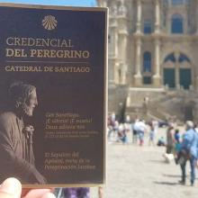 pilgrim credential in front of the Santiago cathedral